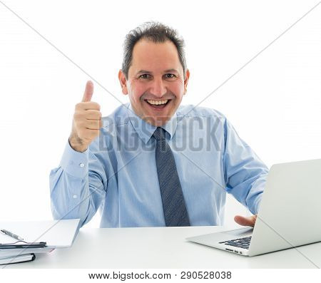 Mature Caucasian Businessman Working On Laptop Computer At Office In Happy Working And Satisfaction