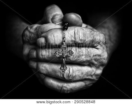 Rosary In Praying Hands Of Senior. Black And White Photography