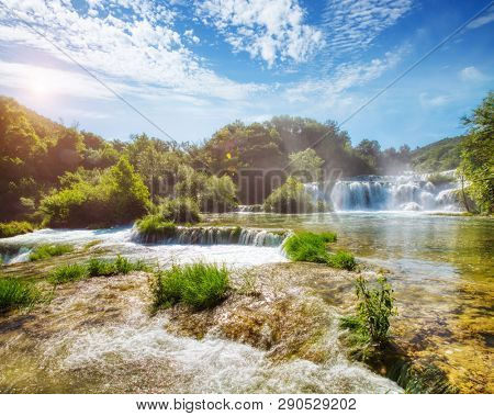 Skradinski buk most popular waterfall in Krka National Park. Location place Sibenik city, Skradin resort (Lozovac), Croatia, Europe. Scenic image of travel destination. Discover the beauty of earth.