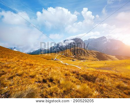 Morning foggy view of the Val di Fassa valley in Dolomite mountains. Location place famous Canazei resort, passo Sella, Dolomiti, Trentino Alto Adige, Italy, Europe. Discover the beauty of world.