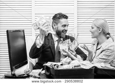 Smiling Businessman With Bundle Of American Dollar Cash Money At Office. Happy Businessman With Heap