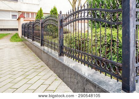 Wrought Iron Fence. A Black Metal Fence