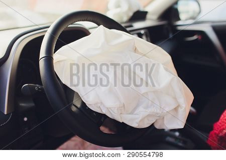 Interior Of A Automobile Or Car Involved In A Vehicle Crash With A Deployed Steering Column Airbag.