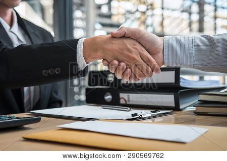 Handshake after finishing conversation Businessman sending a resignation letter to employer boss in order to resign dismiss contract, changing and resigning from work concept. poster