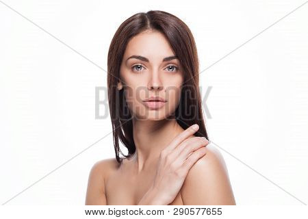 Closeup Studio Portrait Of Young Beautiful Brunette Woman With Hands Near Her Face And Clean Fresh S