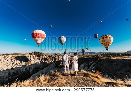 Couple In Love Among Balloons. Loving Couple Rear View. Couple In Love In Cappadocia. Couple In Turk