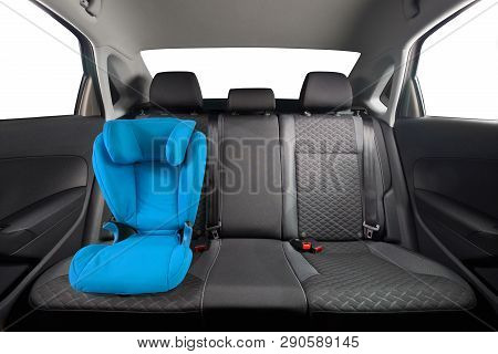 Kid Car Seat In Car. Blue Children Car Seat Installed On Back Seat. Children Safety.