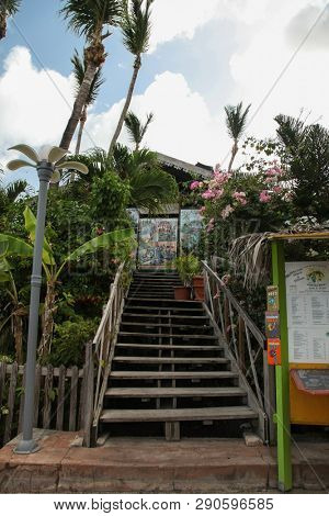 MARIGOT, SINT MAARTEN - JULY 31, 2015: Entrance to Le - Mini club restaurant view from street side In French part island.