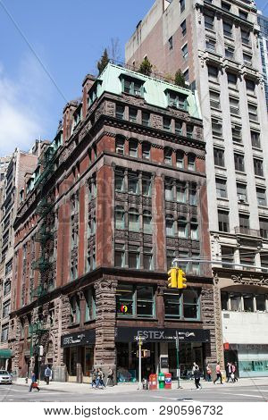 NEW YORK, NY, USA - APRI 22, 2015: Street view with old building with ESTEX home fashions sign on W30th st and 5th Ave