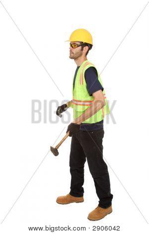 Construction Worker Swinging Three Pound Hammer
