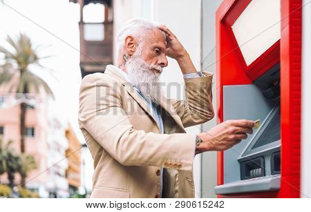 Happy Mature Man Withdraw Money From Bank Cash Machine With Debit Card - Senior Male Doing Payment W
