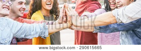 Group Of Diverse Friends Stacking Hands Outdoor - Happy Young People Having Fun Joining And Celebrat