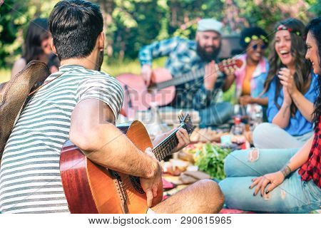Young People Doing Picnic And Playing Guitar In Park - Group Of Happy Friends Having Fun During The