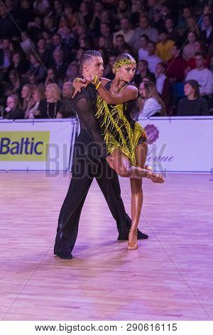 Riga, Latvia-december 15, 2018: Professional Adult Dance Couple Performs Youth Latin-american Progra