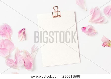 feminine mockup with blank card, rose gold paper clip and pink peony petals - perfect for inspirational quotes, announcements or as a greeting card