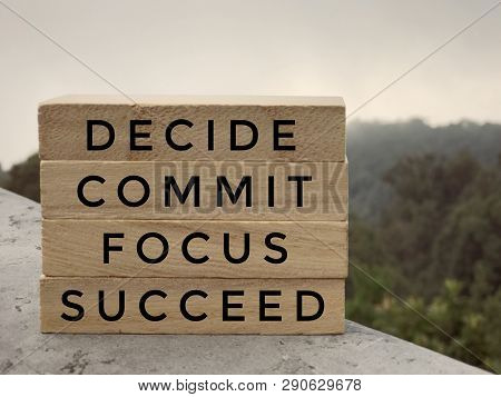 Motivational And Inspirational Words - Decide, Commit, Focus,succeed Written On Wooden Rectangular B