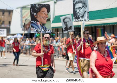Chicago, Illinois, Usa - June 24, 2018 People Carrying Signs With Photos Of Important Gay, Lesbian H
