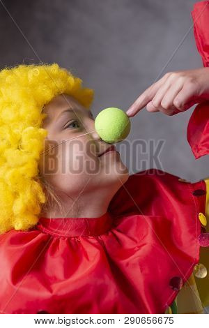 Little Clown Touching Nose In Funny Pose
