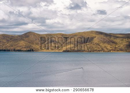 Magnificent Titicaca Lake By Bright Day With Small Motorboat Traces