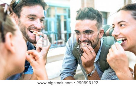 Happy Millenial Friends Having Fun At City Center Eating Sugar Candies - Z Generation Friendship Con