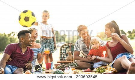 Happy Multiracial Families Having Fun Together With Kids At Pic Nic Barbecue Party - Multicultural J