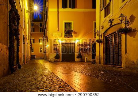 Old Street Of Rome At Night In Italy