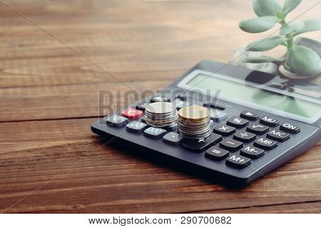 Calculator, Coins Of Euro, Money Tree On Wooden Desk. Concept Of Growing Money, Money Saving, Financ