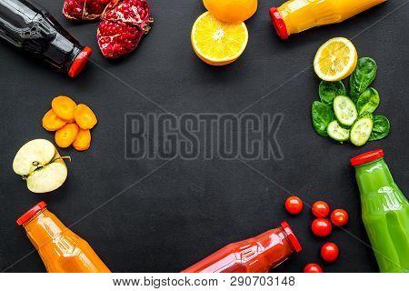 Bottles With Fresh Carrot, Tomato, Apple, Cucumber, Lemon, Pomegranate Juices On Black Background To