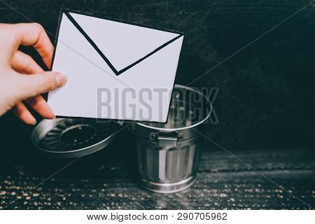 Junk Email Envelope Going In The Trash