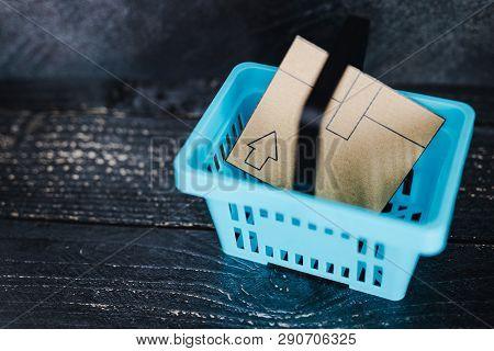 Cardboard Online Delivery Parcel In Shopping Basket