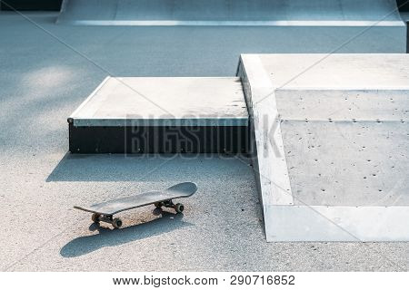 Skateboard in skate park. Extreme sports subculture. Urban lifestyle and adrenaline. Youth relaxation. poster