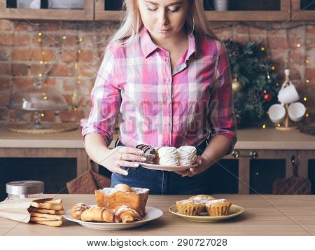Homemade Sweet Bakery. Food Stylist. Female Arranging Plates With Fresh Pastries. Meringues, Muffins