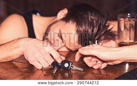 Warning Of Car Accident. Alcoholic Man With Car Keys Sleeping At Bar Counter. Man After Drinking Str