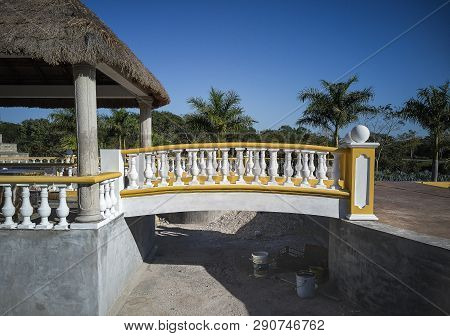 Detail of a Yellow handrail in a Mexican building poster