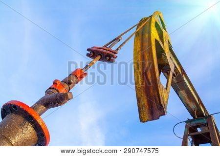 Oil And Gas Industry. Silhouette Oil Pumps On A Sunset Sky Background.oil Industry Equipment. Close