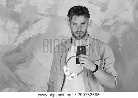 European Guy Have Fun Time. Blue Eyed Stylish Hipster With Smartphone. Cheerful Teenage Dj Listening