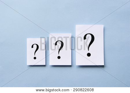 Three Question Marks Of Different Size Printed On White Cards Arranged In Ascending Order Centered O