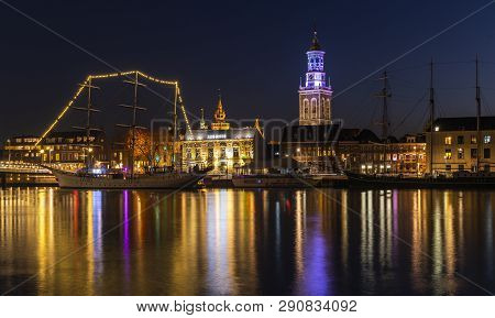 Kampen, Netherlands - February 27, 2019: Monumental City Of Kampen At The River Ijssel With Some Tal