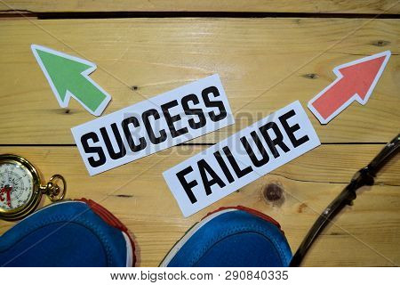Success Or Failure Opposite Direction Signs With Sneakers,eyeglasses And Compass On Wooden Vintage B