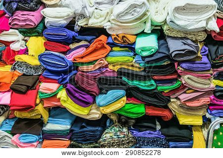 Colorful Fabrics In Warehouse. Rolls Of Fabrics For Sewing.