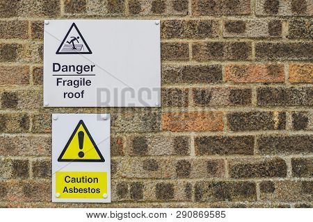 Signs And Notification Of Attention And Danger Hanging On A Wall. Danger Fragile Roof. Caution Asbes