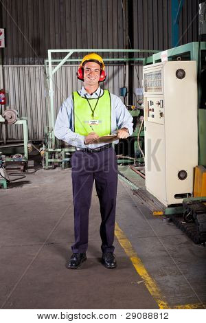 male occupational safety inspector inside factory