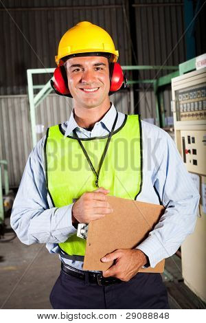 male industrial worker with personal protective equipment inside factory
