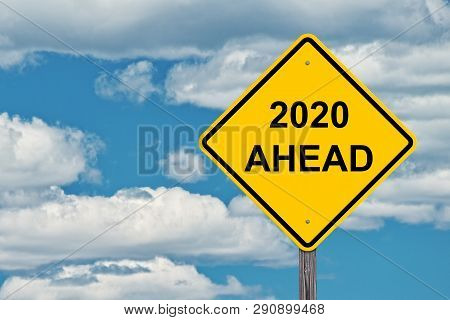 2020 Ahead Caution Sign With Blue Sky Background
