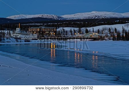 Whitehorse, Yukon, Canada, March 8, 2019 : Night On The Yukon Banks. Whitehorse Is The Capital And O
