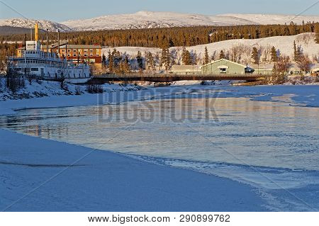 Whitehorse, Yukon, Canada, March 8, 2019 : Sunset On The Yukon Banks. Whitehorse Is The Capital And