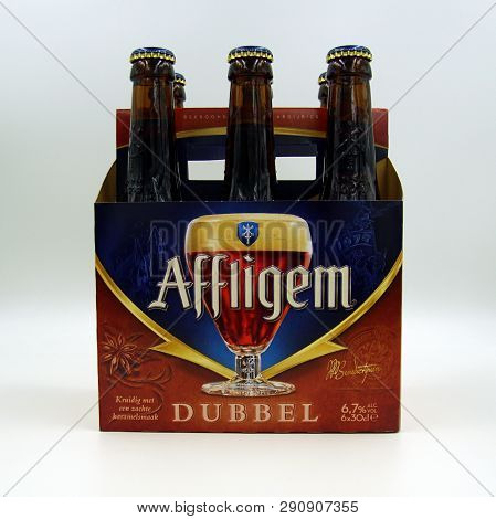 Amsterdam, The Netherlands - March 22, 2018: Sixpack Of Belgian Affligem Dubbel Beers Against A Whit