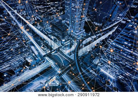 poster of Digital network connection lines of Sathorn intersection, Bangkok Downtown, Thailand. Financial district and business centers in smart urban city in Asia. Skyscraper and high-rise buildings at night.