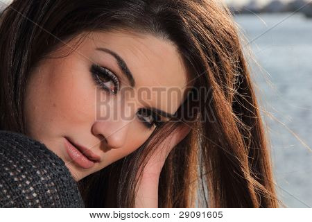 portrait of a beautiful young woman at the sea