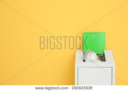 Overfilled Trash Bin On Color Background, Space For Text. Recycling Concept